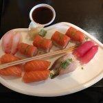 Tuna, mackerel, snapper, salmon nigiri and and a firecracker roll.