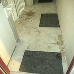 Dirty entrance to our room.  The ground needed to be powerwashed.