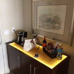 in room coffee maker, mini bar/snacks, refrig in cabinet as well as safe
