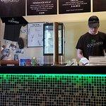 The menu board and prep counter at Coriander.