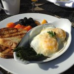 Outstanding: sunny side eggs on a bed of prosciutto wrapped asparagus, grilled toast & fruit