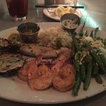 Charbroiled shrimp and oysters, fish, drawn butter, and two sides.