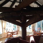 The old water wheel inside the open plan dining/sitting rooms.