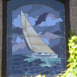 Closeup of sailboat in stained glass at Dry Creek Winery