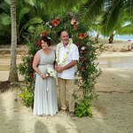 Our wedding day , on the beach in front of our bungalow