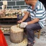 Local craftsman shaping bamboo