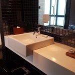 Sleek contemporary bathroom design - dig the black tiles