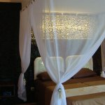One of the romantic rooms near the sea with the queen size bed, bathroom and large terrace overl