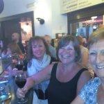 Friends enjoying a drink and a tapa at Redondo's