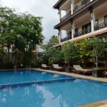 The pool is situated in lovely surroundings.