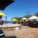 Central Hermanus, communal outdoor food area with DJ on platform - and lady singer (both really