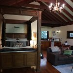 Currawong Cottage has plenty of living space, a kitchenette and romantic four-poster bed