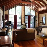 The Currawong Cottage floor to ceiling rooms allows views to the gardens beyond