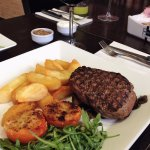 Fillet Steak, Hand Cut Chips, Tomatoes Gratni, Dressed Rocket Salad, And A Glass Of Passori Ross