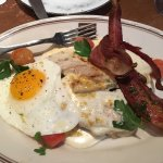 Hot Brown, Sunny Side Egg, Grilled Turkey, Sorghum Bacon, Tomato and Mornay Sauce