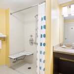 ADA Suite Bathroom with roll in shower.