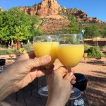Celebrating our wedding anniversary with traditional mimosas and breakfast outside our room