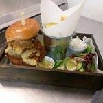 BBQ pulled pork burger served with skin on fries, homemade onion rings, salad and apple sauce