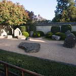 Japanese sand and stone garden. Italian Renaissance Garden's pergola is peeking at rear