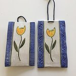 Various decorative pottery pieces such as these tulip wall hangings.