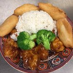 General Gau Chicken combination plate with chicken fingers and white rice.