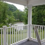 Large porch outside Suite 4 ... Loved the relaxing sound of the rapidly flowing French Broad Riv