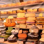 Cheese stall in the open market outside the Town hall