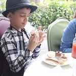 CANDID CLICK, A KID ENJOYING HIS DESSERTS
