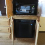 Microwave and mini-refridge hidden in the armoire