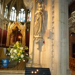 Statue of Our Lady with votive candles