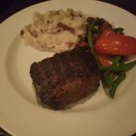 12 oz baseball sirloin blue rare finished Chicago style with garlic mashed potatoes and vegetabl