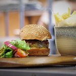 AGED CUMBRIAN BEEF BURGER  toasted brioche bun, tomato relish, Cumbrian cheddar, pickles and fri