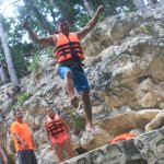 Jumping into the Cenote.