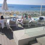 On Saturday, the beach is crowded and the overlooking hotel pool is a perfect spot