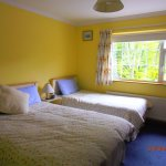 Twin bedded room with private toilet and shower facilities . Tea/Coffee, TV Radio and free WiFi