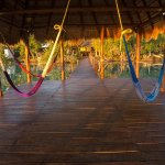 Lay down in our hammocks palapa of our pier and enjoy the breeze from the lagoon