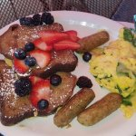 Banana bread french toast w/ fruit, chicken sausage & scrambled eggs w/ onions & spinach