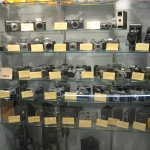 "A variety of old film cameras (in the ""photo shop"")"