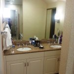 Large bathroom with double vanities and jacuzzi tub