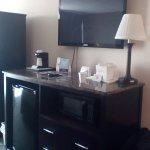 Fridge, microwve, safe; marble top; TV , closet.