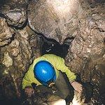 Climbing up an underground waterfall