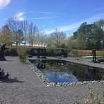 Outdoor reflecting pond surrounded by Rodin statuary.