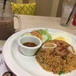 Tom yum fried rice (spicy) with an iced milo