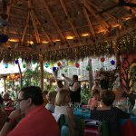 Dining under the thatch roof, beachside.