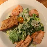 Salmon fillets on caesar salad