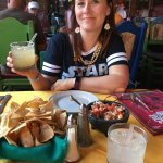 Enjoying strong margaritas, chips and salsas.