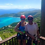 Father/daughter doing the zip line on st thomas