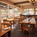 Light filled rooms and warm decor add to the relaxed ambiance of The Long Table for lunch or din
