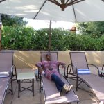Relaxing at the pool area, awaing drinks, of course!!