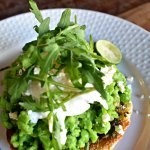 Smashed peas and avocado on toast with poached egg